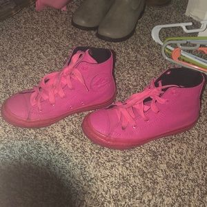 Girls all leather pink high top converse.